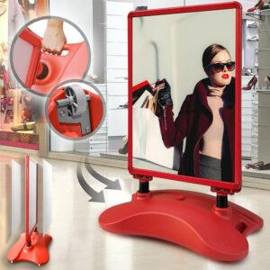 Kundenstopper rot mit Wassertank positioniert vor einem Fashiongeschäft für Aktionen & Rabatte